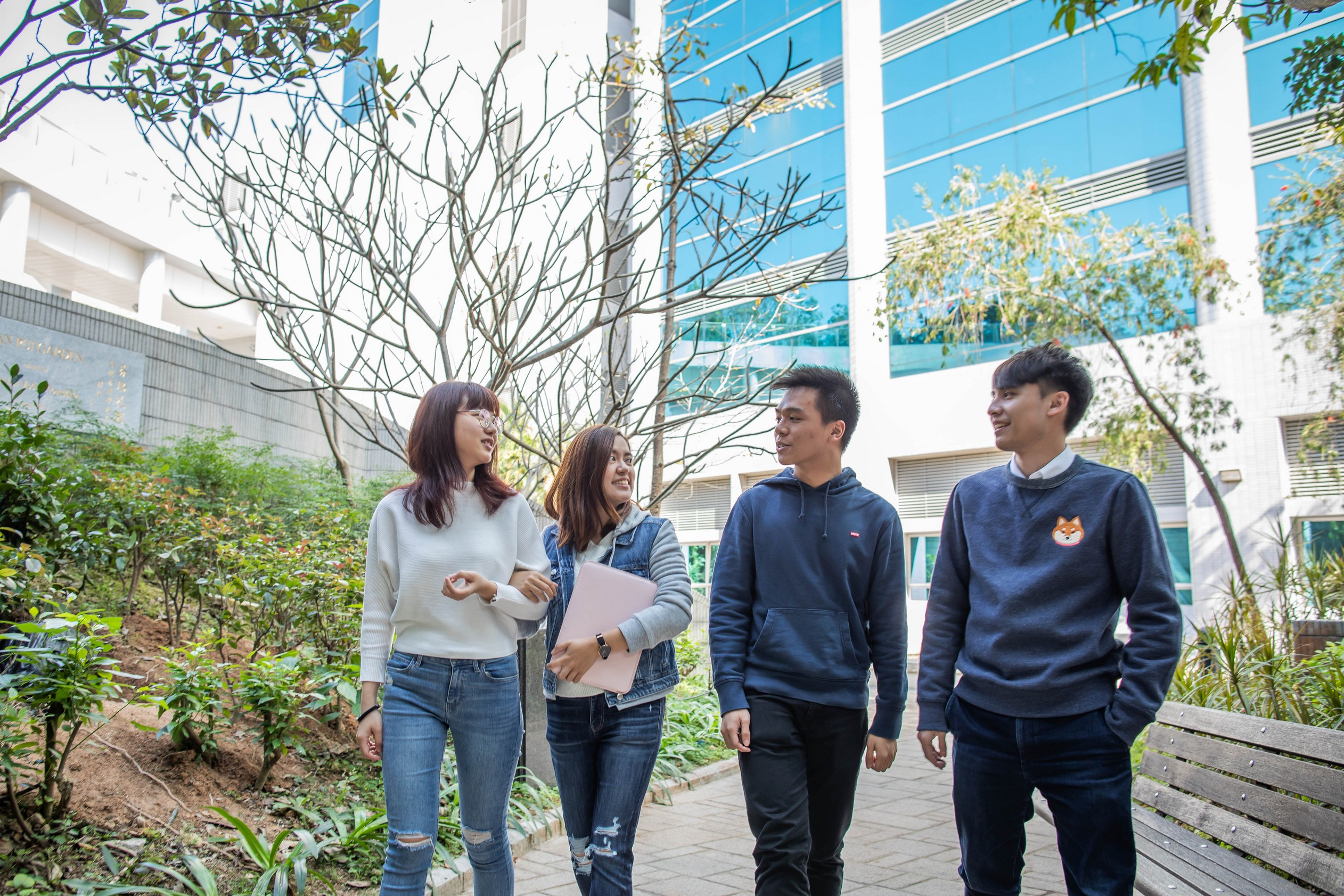 Group of students having a walk in Fan Pui Garden at medical campus.